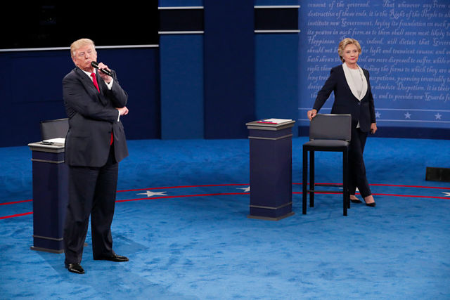 Donald Trump Lurks Behind Hillary Clinton During 2016 Debate, Sparks Viral Meme